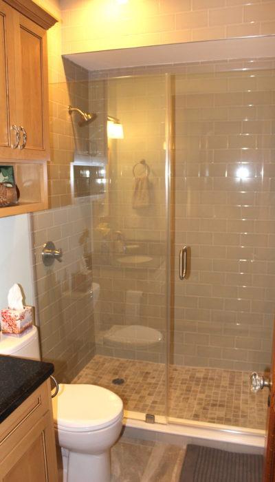 Bathroom glass door tile shower.