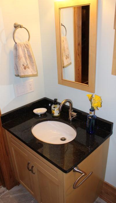 Bathroom sink and mirror.